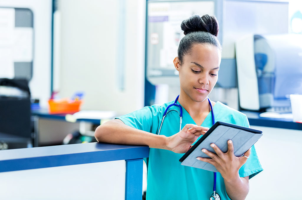 Nurse updates information on a tablet