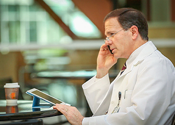 Doctor reviewing electronic records