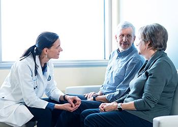 Doctor listening to elderly patients