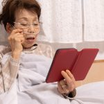Elderly sick woman resting in bed